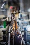 Υπόλοιπος κόσμος των μπουκαλιών στο μεταφορέα Στοκ Εικόνες
