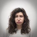 Δυστυχισμένο μπερδεμένο κορίτσι Στοκ εικόνα με δικαίωμα ελεύθερης χρήσης