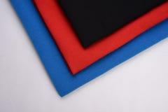 Υφάσματα τρία διαφορετικά χρώματα που γίνονται με από την ίνα βαμβακιού Στοκ εικόνες με δικαίωμα ελεύθερης χρήσης