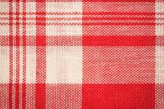Υφαντική επιφάνεια Κόκκινη και άσπρη σύσταση υφασμάτων Στοκ εικόνες με δικαίωμα ελεύθερης χρήσης