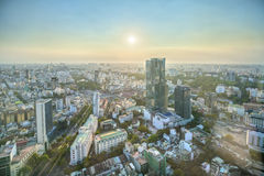 Υψηλός ορίζοντας Saigon άποψης όταν λάμπει ο ήλιος κάτω από αστικό Στοκ Φωτογραφία