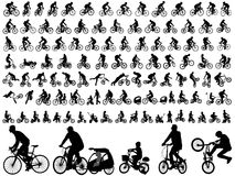 Υψηλός - σκιαγραφίες ποιοτικών bicyclists Στοκ Φωτογραφίες