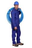 Υδραυλικός με τον μπλε σωλήνα στοκ φωτογραφίες με δικαίωμα ελεύθερης χρήσης