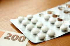 Φάρμακα και χρήματα στοκ εικόνες