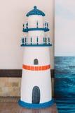 Φάρος ως διακόσμηση για το κόμμα θάλασσας γενεθλίων Στοκ Φωτογραφία