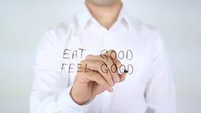 Φάτε καλό αισθάνεται καλός, άτομο που γράφει στο γυαλί Στοκ φωτογραφία με δικαίωμα ελεύθερης χρήσης