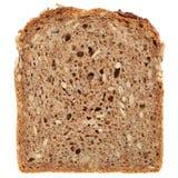 Φέτα ολόκληρου ενός ψωμιού σίτου Στοκ φωτογραφία με δικαίωμα ελεύθερης χρήσης