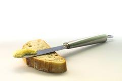 Φέτα ψωμιού με το βούτυρο στοκ εικόνες