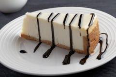 Φέτα cheesecake με liquorice τη σάλτσα Στοκ Εικόνα