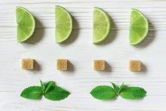 Φέτες, μέντα και κύβοι ασβέστη της καφετιάς ζάχαρης Συστατικά για το Moji Στοκ φωτογραφία με δικαίωμα ελεύθερης χρήσης