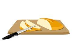 Φέτες του ψωμιού στον τέμνοντα πίνακα Στοκ Εικόνα