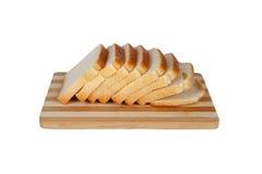 Φέτες του ψωμιού φρυγανιάς Breadboard στοκ φωτογραφία