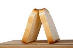 Φέτες του ψωμιού φρυγανιάς Breadboard στοκ φωτογραφίες με δικαίωμα ελεύθερης χρήσης