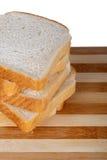 Φέτες του ψωμιού φρυγανιάς Breadboard στοκ εικόνα
