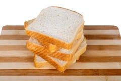 Φέτες του ψωμιού φρυγανιάς Breadboard στοκ εικόνες με δικαίωμα ελεύθερης χρήσης