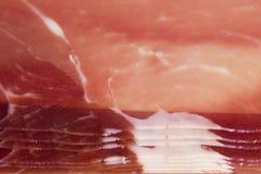 Φέτες του jamon στο πλαίσιο Στοκ εικόνα με δικαίωμα ελεύθερης χρήσης