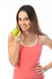 Φίλαθλο κορίτσι αερόμπικ που προσφέρει το μήλο Στοκ Εικόνα