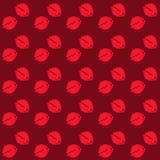 Φίλημα σε ένα κόκκινο υπόβαθρο άνευ ραφής Στοκ Εικόνες