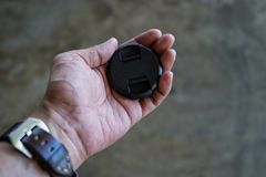 Φακός ΚΑΠ εκμετάλλευσης χεριών ατόμων Στοκ Εικόνες