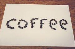 Φασόλια καφέ επιγραφής Στοκ Εικόνες