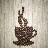 Φλυτζάνι φασολιών καφέ στοκ εικόνα με δικαίωμα ελεύθερης χρήσης