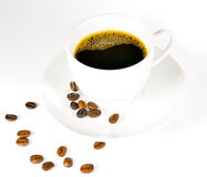 Φασόλια καφέ και φλυτζάνι καφέ Στοκ Φωτογραφία
