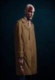 Φαλακρό άτομο με ένα σπασμένο κεφάλι Στοκ Εικόνα