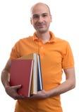 Φαλακρό άτομο που κρατά μερικά βιβλία Στοκ Εικόνες
