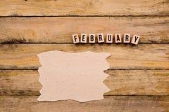Φεβρουάριος - ημερολογιακός μήνας στα ξύλινα κεφαλαία γράμματα με χειροποίητο Στοκ φωτογραφία με δικαίωμα ελεύθερης χρήσης