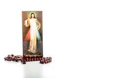 Φιλεύσπλαχνες εικόνας και Rosary του Ιησού χάντρες Στοκ Εικόνα