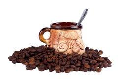 Φλυτζάνι και σπόροι καφέ Στοκ εικόνες με δικαίωμα ελεύθερης χρήσης