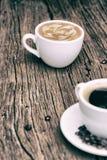 Φλυτζάνι καφέ με τα φασόλια καφέ και τα φύλλα καφέ Στοκ φωτογραφίες με δικαίωμα ελεύθερης χρήσης