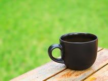 Φλυτζάνι καφέ στον πίνακα Στοκ Φωτογραφίες