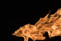 Φλόγα της πυρκαγιάς σε ένα μαύρο υπόβαθρο 2 Στοκ Εικόνα