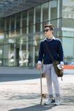 Φοιτητής πανεπιστημίου με skateboard Στοκ Φωτογραφίες