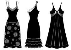 Φορέματα γυναικών στο λευκό. Διανυσματική μαύρη σκιαγραφία Στοκ φωτογραφία με δικαίωμα ελεύθερης χρήσης