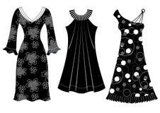 Φορέματα γυναικών. Διανυσματικές μαύρες σκιαγραφίες των ενδυμάτων   Στοκ Εικόνες