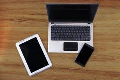 Φορητός προσωπικός υπολογιστής με την ταμπλέτα και το smartphone Στοκ Φωτογραφίες