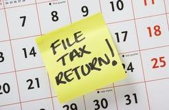 Φορολογική επιστροφή αρχείων! Στοκ Φωτογραφίες