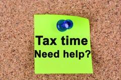 Φορολογικός χρόνος, ερώτηση βοήθειας ανάγκης στις σημειώσεις Στοκ Φωτογραφίες