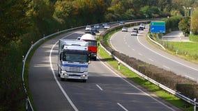 Φορτηγά στην κυκλοφορία αυτοκινητόδρομων Στοκ Εικόνες