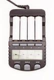 Φορτιστής μπαταριών με τις μπαταρίες που απομονώνονται στοκ φωτογραφία με δικαίωμα ελεύθερης χρήσης