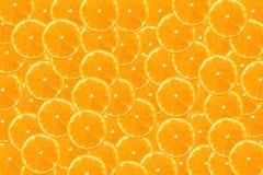 Φρέσκα πορτοκάλι και υπόβαθρο φετών Στοκ Φωτογραφίες