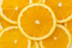 Φρέσκα πορτοκάλι και υπόβαθρο φετών Στοκ Εικόνα