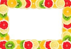 Φρέσκα τροπικά φρούτα που απομονώνονται σε ένα λευκό Πλαίσιο για το μήνυμα κειμένου Στοκ φωτογραφία με δικαίωμα ελεύθερης χρήσης