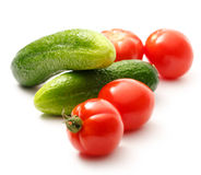 Φρέσκες αγγούρια και ντομάτες στο λευκό Στοκ εικόνες με δικαίωμα ελεύθερης χρήσης