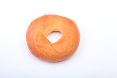 Φρέσκο αυθεντικό bagel ύφους της Νέας Υόρκης που απομονώνεται στο υπόβαθρο υφασμάτων καμβά Στοκ φωτογραφίες με δικαίωμα ελεύθερης χρήσης