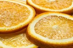 Φρέσκο υπόβαθρο φρούτων περικοπών πορτοκαλί, πολλά κομμάτια των πορτοκαλιών, μακρο στενή επάνω φωτογραφία Στοκ φωτογραφίες με δικαίωμα ελεύθερης χρήσης