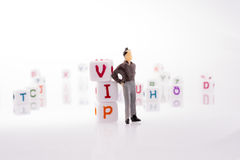 Φραγμοί αλφάβητου και ο VIP λέξης και το άτομο Στοκ φωτογραφία με δικαίωμα ελεύθερης χρήσης