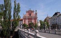 Φραντσησθανή εκκλησία Annunciation και τριπλής της γέφυρας στο Λουμπλιάνα, Σλοβενία Στοκ Εικόνες